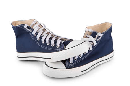 Pair of new blue sneakers with shadow on white background