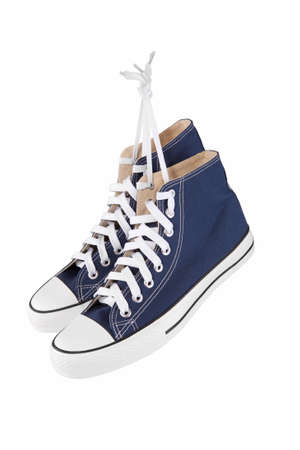 Pair of new blue sneakers isolated on white photo