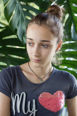 Teenage girl with pink heart on her T-shirt photo