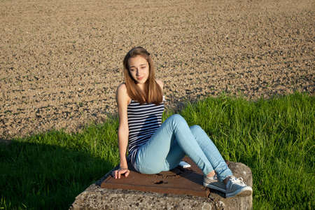 teen girl: Cute teenage girl in the field Stock Photo