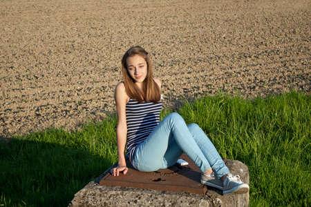 Cute teenage girl in the field photo