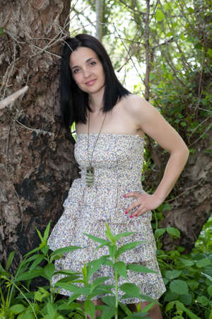 Young woman in the forest photo