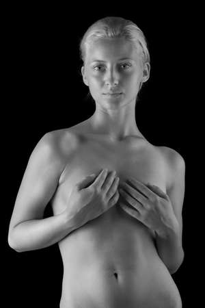 b&w beautiful naked body of young and sexy woman isolated on black background Stock Photo - 14443067