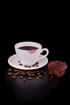kiss biscuits: Hot coffee cup with red lipstick and muffin on black