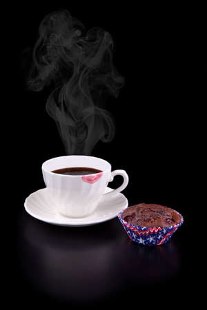 evaporate: Hot coffee cup with red lipstick and muffin on black