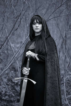 cloak: Portrait of a medieval lady with sword  black and white