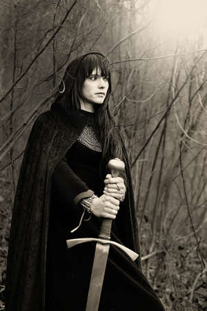Portrait of a medieval lady with sword  sepia toned  Stock Photo