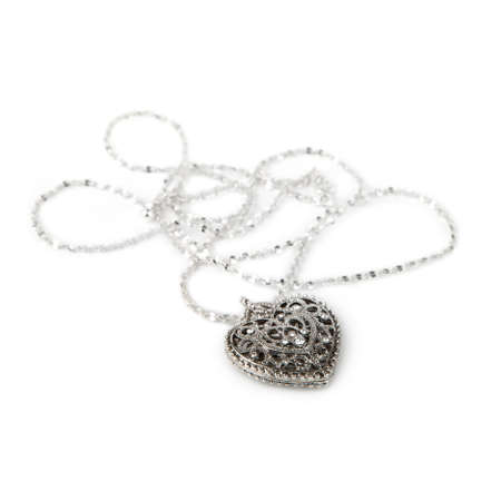 jeweller: Silver heart pendant necklace, Isolated on white  Stock Photo