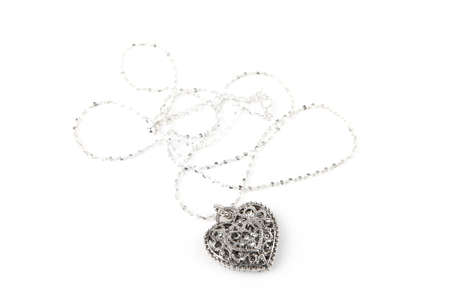 Silver heart pendant necklace, Isolated on white  photo