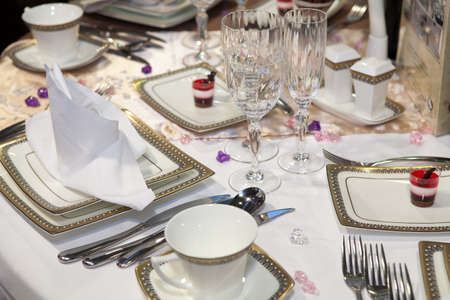Elegant table set for a wedding dinner photo