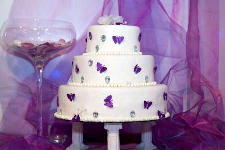 Wedding cake with purple butterflies photo