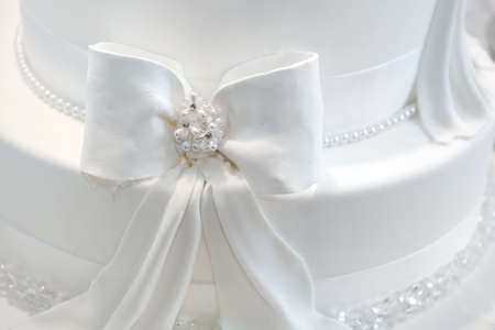 Wedding cake detail - a ribbon with pearls Stock Photo