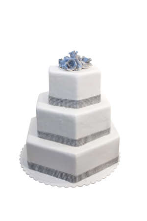 Three tiered wedding cake decorated with diamonds, isolated on white photo