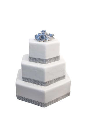 tiered: Three tiered wedding cake decorated with diamonds, isolated on white