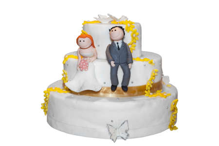 Bride and groom figurines on top of a wedding cake  photo