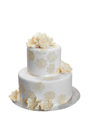 Elegant Wedding Cake with Beige flowers, isolated on white photo