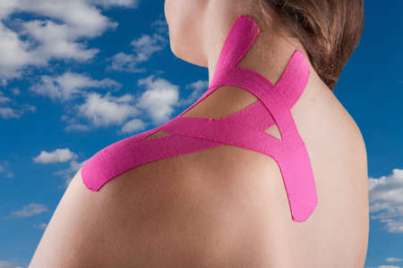 Therapy with kinesio tex tape against a blue sky Stock Photo