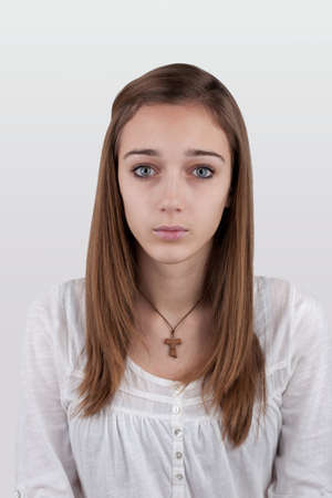 apathetic: Portrait of a young female caucasian teen, on white