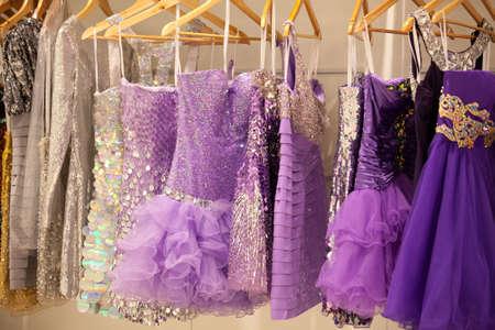 sleeveless: Glitter dresses in a closet store