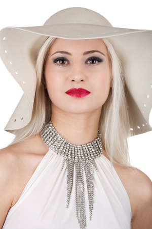 Beautiful young woman with diamond necklace and a hat photo