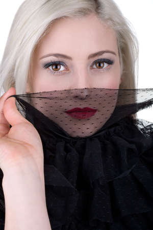 A beautiful young woman wearing a lace collar photo