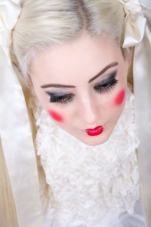Girl with a dolly makeup photo