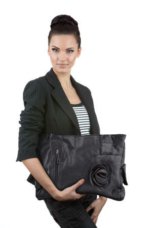 Beautiful business woman holding a purse, isolated on white