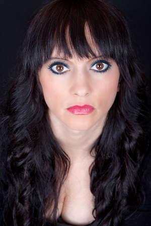 strict: Portrait of a beautiful brunette with a piercing gaze