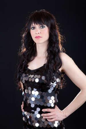 Beautiful brunette on black background photo