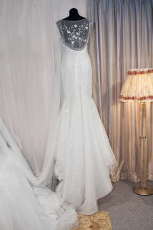Beautiful wedding dress on a mannequin in a bridal shop photo