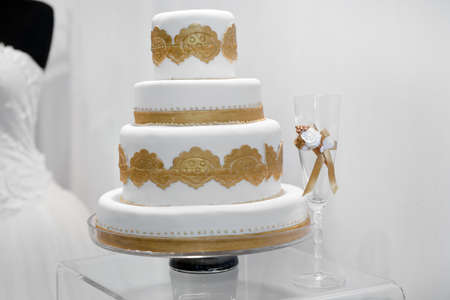 Beautiful wedding cake with golden ornaments Stock Photo