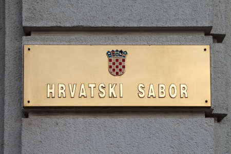 Golden metal plate on the Croatian Sabor or Parliament in Zagreb, Croatia  The current building dates from the beginning of the 20th century