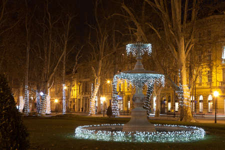 "popularly: The first fountain at Zrinjevac decorated by Christmas lights  Because of its swelling, organic shape the fountain is popularly known as ""The Mushroom""  Editorial"