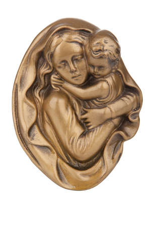 son of god: Virgin Mary holding baby Jesus wall statue Stock Photo