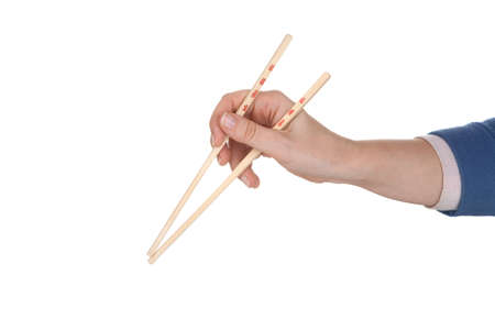 Female hand holding chopsticks with chinese unidentifiable inscription  photo