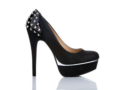 heeled: Black platform shoe with studs, isolated on white