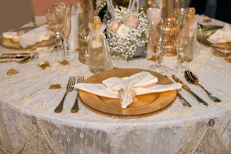 wedding table setting: Luxurious wedding dinner with golden theme