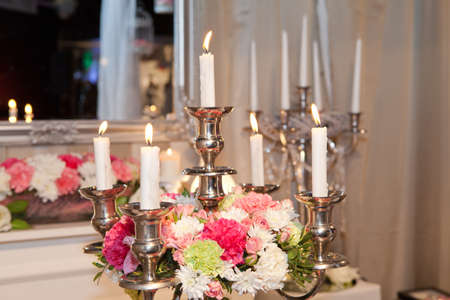 Candle holder decorated with flowers photo