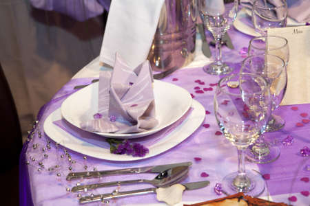 Detail of a wedding dinner setting in purple theme photo