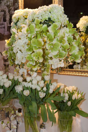 White tulips and orchids decorating the room photo
