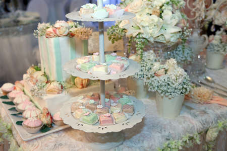 Colorful cakes on a banquet photo