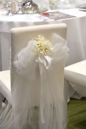 tulle: Detail of a chair decorated for a wedding reception Stock Photo
