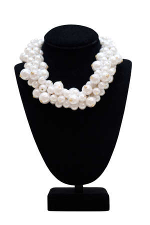 Pearl necklace on black mannequin, isolated on white photo