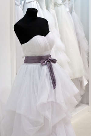 purple dress: Wedding dress on a mannequin in the showroom