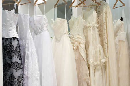 purple dress: Bridal shop with wedding dresses on hangers