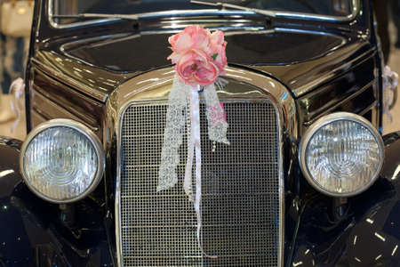 Vintage car with wedding bouquet photo