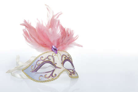Beautiful carnival mask with pink feathers and a reflection, copy space on the right photo