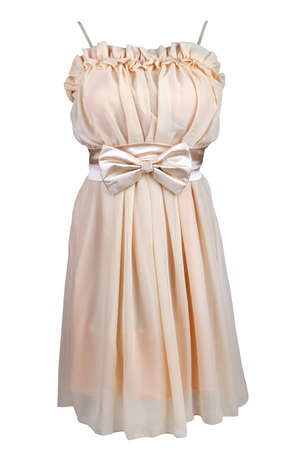 Beige cocktail dress with satin bow, isolated on white photo