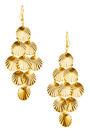 Pair of golden earrings isolated on white background  photo