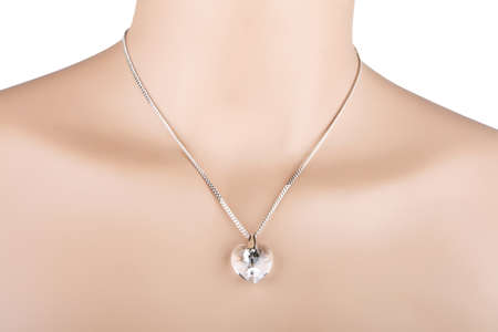 Silver necklace with glass heart pendant on a mannequin Stockfoto